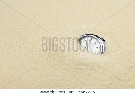 Ancient Mechanical Watch In Sand