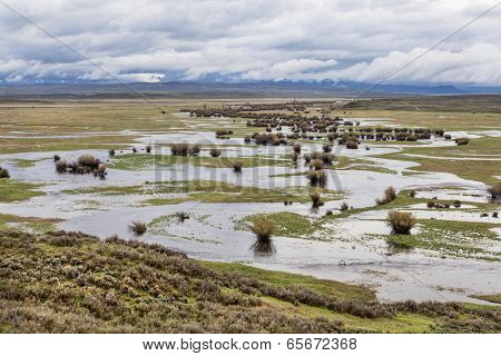 Illinois River meanders through Arapaho National Wildlife Refuge, North Park near Walden, Colorado, spring scenery with flooded meadows