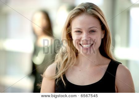 Attractive Blonde Woman Smiling Broadly