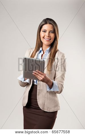 Young beautiful business woman holding tablet