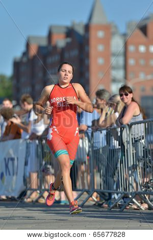 DNEPROPETROVSK, UKRAINE - MAY 24, 2014: Angelina Borodina of Belarus runs on the third stage of ETU Sprint Triathlon European cup. It's the first time Triathlon European Cup take place in Ukraine