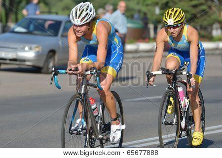 DNEPROPETROVSK, UKRAINE - MAY 24, 2014: Oleksandra Stepanenko (left) and Inna Ryzhykh of Ukraine race on the second stage of ETU Sprint Triathlon European cup