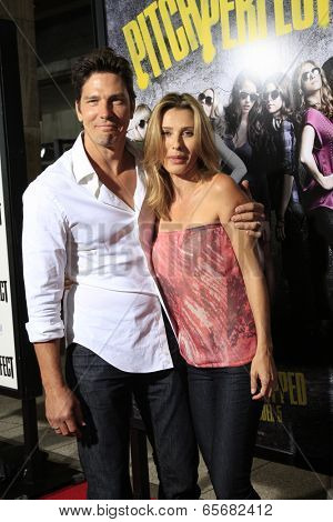 LOS ANGELES - SEP 24:  Michael Trucco, Sandra Hess arrives at the