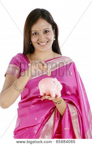 Young Indian Traditional Woman Inserting A Indian Ten Rupee Coin