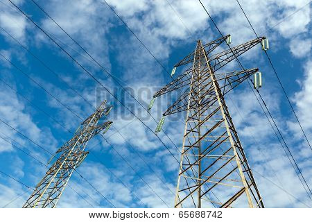 Power Line And Blue Sky With Clouds