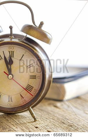Clock and Bible on wood