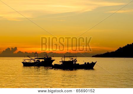 Fishing Boats at sunset on sea