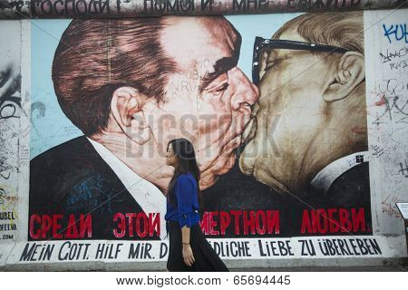 BERLIN, GERMANY - MAY 23, 2014: Graffiti Kiss between Brezhnev and Honecker by Dm.Vrubel on Berlin Wall at East Side Gallery. Berlin Wall collapsed in 1989 and now is largest world graffiti gallery.