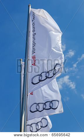 Samara, Russia - May 24, 2014: The Flag Of Audi Over Blue Sky. Audi Ag Is A German Automobile Manufa