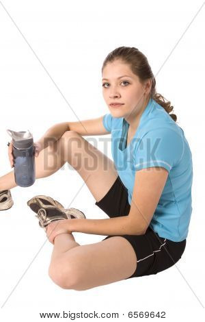 Woman Sitting With Bottle Of Water