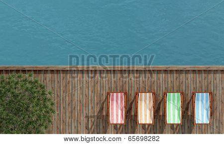 Deckchairs On A Wooden Pier