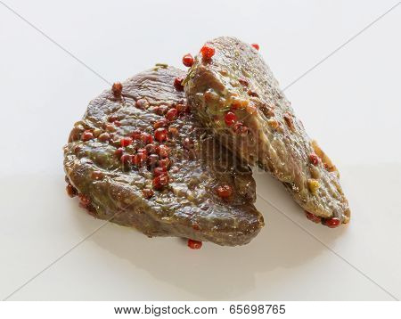 Raw Beef Steak Isolated In Marinade
