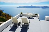 stock photo of yacht  - The sea view terrace at luxury hotel Santorini island Greece - JPG