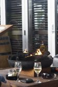 image of apr  - Relaxing in winter time on an outdoor terrace with wine and fire - JPG