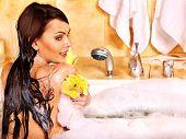 picture of bath sponge  - Young woman take bubble  bath - JPG