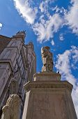 stock photo of alighieri  - Dante Alighieri monument in front of a Santa Croce basilica and square in Florence - JPG