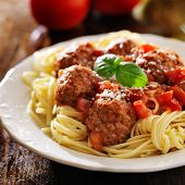 stock photo of spaghetti  - spaghetti and meatballs with basil garnish - JPG
