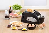 pic of multi purpose  - Multi purpose bread toaster it has function for boiling and frying egg also - JPG