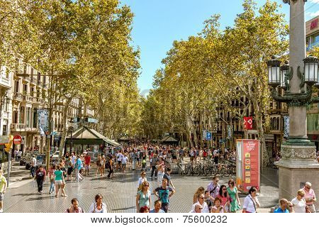 BARCELONA, SPAIN - JUNE 02: Crowded La Rambla street at the heart of Barcelona, Spain at night time with the Liceu Theater on the right on June 02, 2013.