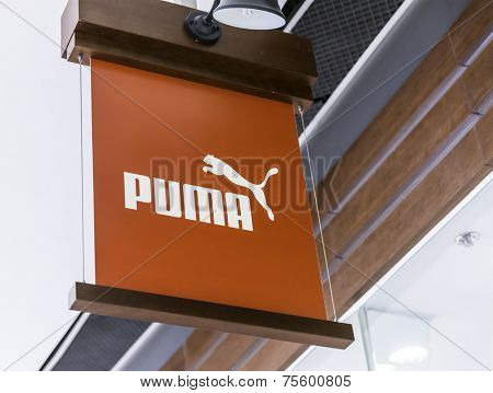 HONG KONG - CIRCA MARCH 2014: Puma sign is displayed at the facade of a Puma Store; Puma, a major German multinational company, produces athletic and casual footwear, as well as sportswear.