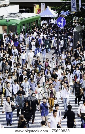TOKYO, JAPAN - CIRCA MAY 2014: Pedestrians crossing the busiest crosswalk in the world in the Shibuya district in Tokyo, Japan.