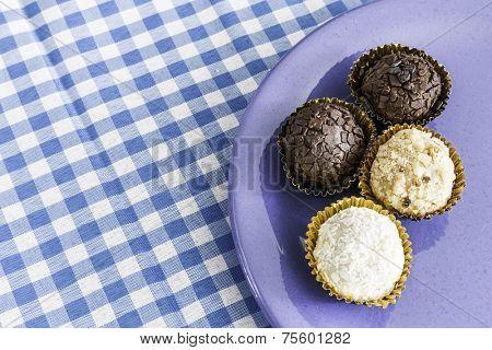 Brazilian sweeties on a blue plate