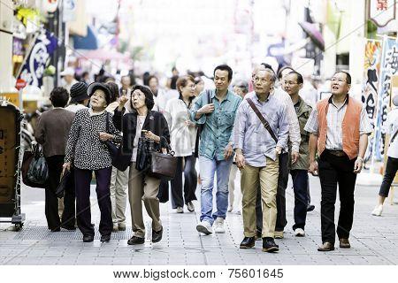 TOKYO, JAPAN - CIRCA MAY 2014: People walking through Asakusa district in Tokyo, Japan.