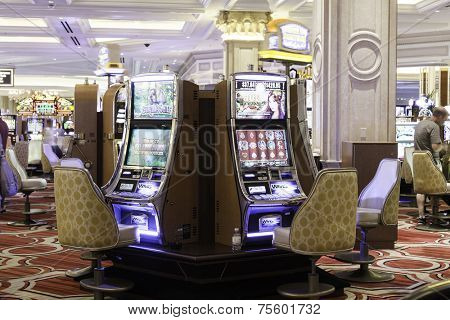 LAS VEGAS, NEVADA, USA - CIRCA JAN 2014: Slot machines in the Belaggio Hotel in Las Vegas. Bellagio is one of the most luxurious hotels in Las Vegas