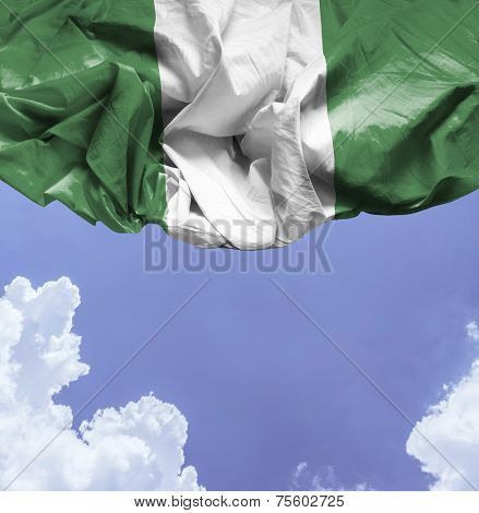 Nigeria waving flag on a beautiful day