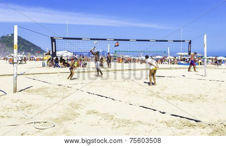 RIO DE JANEIRO, BRAZIL - CIRCA NOV 2013: People playing volleyball in Copacabana Beach in Rio de Janeiro, Brazil.