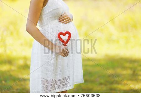 Pregnancy, Maternity, Family - Concept, Pregnant Woman And Heart Symbol