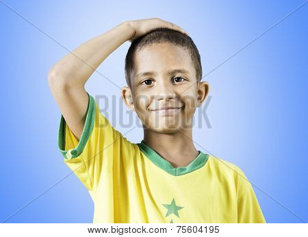 Brazilian little boy putting his hand on his head on blue background