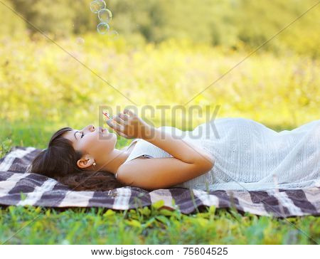 Pregnant Woman Resting In Summer Day