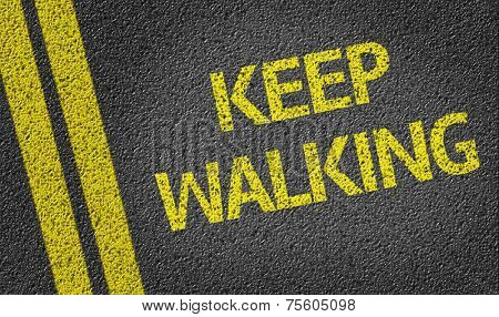 Keep Walking written on the road