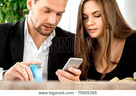 Young couple paying for ther order at the restaurant