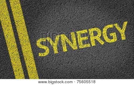 Synergy written on the road