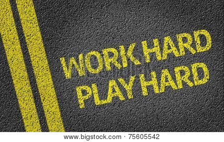 Work Hard Play Hard written on the road