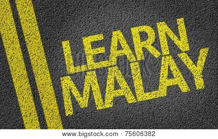 Learn Malay written on the road