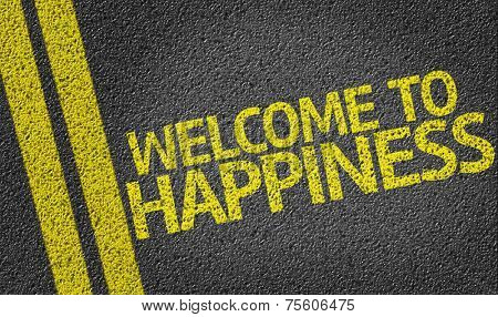 Welcome to Happiness written on the road