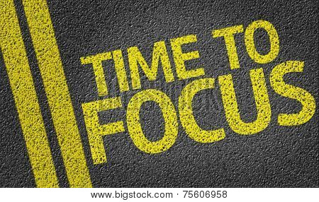 Time to Focus written on the road