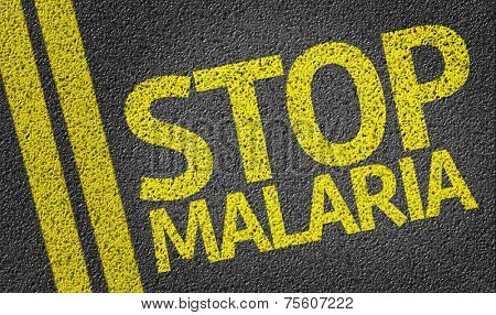Stop Malaria written on the road