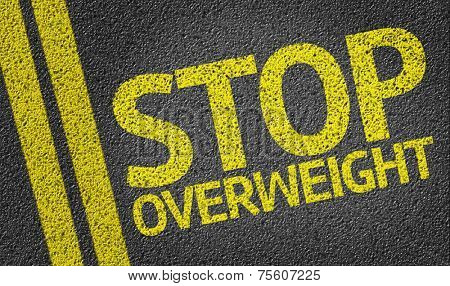 Stop Overweight written on the road