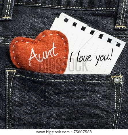 Aunt I love you! written on a peace of paper and a heart on a jeans background