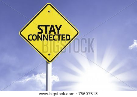 Stay Connected road sign with sun background