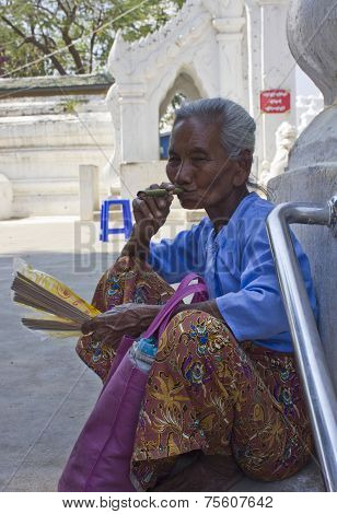 Old Asiatic Woman Smoking An Handmade Cigar