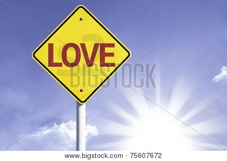 Love road sign with sun background