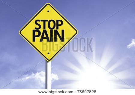 Stop Pain road sign with sun background