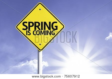 Spring is Coming road sign with sun background