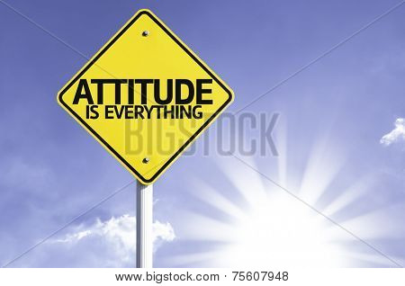 Attitude is Everything road sign with sun background