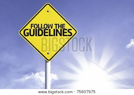Follow the Guidelines road sign with sun background